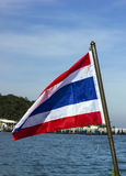 Thai flag against blue sky Royalty Free Stock Images