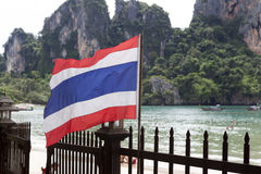 Thai flag in the background sandy beach .Tayland Krabi. Stock Image