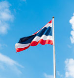 Thai flag at blue sky with cloud Royalty Free Stock Photos