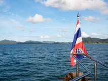 Thai flag on boat in Krabi, Thailand. A Thai flag adorns the front of the boat traditionally where its spirit lives.  Travelling the Andaman Sea from Phi Phi Royalty Free Stock Photo