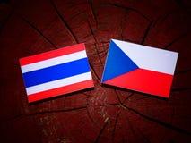 Thai flag with Czech flag on a tree stump  Royalty Free Stock Photos