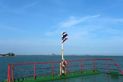 Thai flag on the ferry in  sea Royalty Free Stock Photography