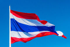 Thai flag of Thailand with blue sky background. Royalty Free Stock Photos