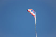 Thai flag of Thailand waving on blue sky Royalty Free Stock Image