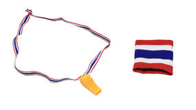 Thai flag wristband and yellow whistle Royalty Free Stock Images