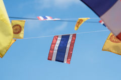 Thai flags and buddhism yellow flags in the temple. Stock Photo