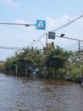 Thai Flood. Phetkasem 81, Bangkok, Thailand - November 3 : Heavy flooding from monsoon rain in center of Thailand arriving in Bangkok suburbs on November 3, 2011 Royalty Free Stock Image