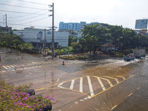 Thai Flood. Phetkasem Road, Bangkok, Thailand - November 3 : Heavy flooding from monsoon rain in center of Thailand arriving in Bangkok suburbs on November 3 Stock Photo