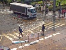 Thai Flood. Phetkasem Road, Bangkok, Thailand - November 3 : Heavy flooding from monsoon rain in center of Thailand arriving in Bangkok suburbs on November 3 Royalty Free Stock Image