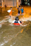 Thai flood hits Central of Thailand. BANGKOK, THAILAND - OCT 31: unidentified Kids playing in flood water during the worst flooding in decades  on October 31 Royalty Free Stock Photos