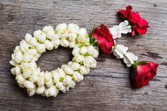 Thai flower garland on wooden table. Thai flower garland on old wooden table background Royalty Free Stock Images