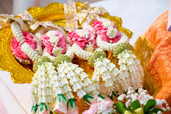 Thai flower garlands on a tray with pedestal Stock Image