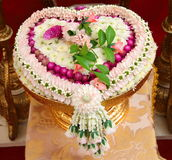 Thai flower heart shaped garland. On golden tray with pedestal use for blessed water in Thai wedding ceremony Stock Photography