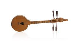 Thai folk style wooden guitar Royalty Free Stock Photo