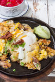 Thai food. Fried chicken with eggs and noodle Royalty Free Stock Images