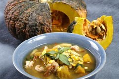Thai food. Thai style soup with herb and pumkin Royalty Free Stock Images