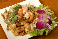 Thai food. Shrimps salad with spicy herbs Stock Photos