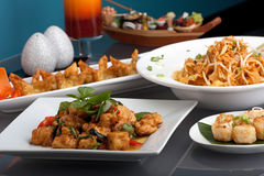 Thai Food Assortment. A big assortment of Thai foods and appetizers presented beautifully with fancy garnish Stock Photography