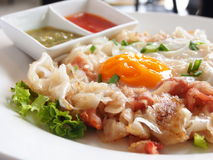 Thai food. Baked omelette with bacon on a white plate Stock Photos
