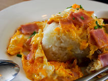 Thai food. Baked omelette with bacon on a white plate Stock Images