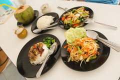 Thai food. On black plates with coconut Stock Photo