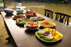 Thai food on the boat. The picture show various thai dishes on the table that made from boat Royalty Free Stock Photography