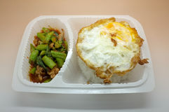 Thai food box, Fried egg over rice with stir fried chicken and vegetable Royalty Free Stock Images
