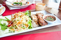 Thai food call SOMTAM and grill chicken. Delicious Thai food call SOMTAM and grill chicken with stricky rice stock photos
