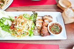 Thai food call SOMTAM and grill chicken. Delicious Thai food call SOMTAM and grill chicken with stricky rice Stock Photo