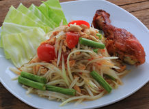 Thai food call SOMTAM. And grill chicken Royalty Free Stock Photo