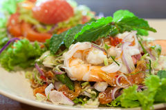 Thai food, Close up spicy shrimp salad on wood table Stock Photography