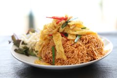 Thai food crisp fried noodles. On a plate royalty free stock photo
