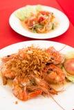 Thai food cuisine fresh exotic fried shrimp delicacy. Delicious healthy Thai food cuisine fresh exotic fried shrimp delicacy served on a white plate with salad Stock Photo
