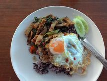 Thai food. Eat dish spoon egg rice vegetables Stock Photo