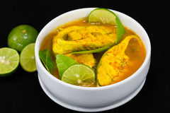Thai Food  Fish Curry with Lemon slice On Black. Royalty Free Stock Image