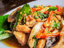 Thai food, fish decorated with Thai herb spices red chili with k Stock Photos