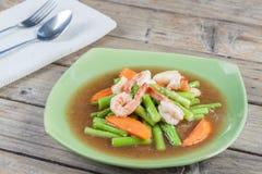 Thai Food: Fried asparagus with shrimp as food taste delicious. Stock Photos