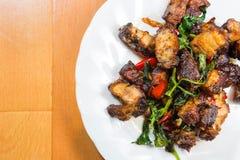 Thai food fried basil with crispy pork. Royalty Free Stock Photo