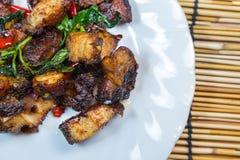 Thai food fried basil with crispy pork. Royalty Free Stock Photography