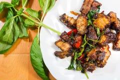 Thai food fried basil with crispy pork. Royalty Free Stock Photos