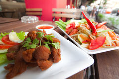 Thai Food fried chicken and Papaya Salad. Popular Thai food is Papaya Salad or `Som Tum` serve with Fried chicken Stock Images