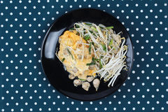 Thai food,Fried egg and oyster with bean sprouts and shallot as. Fried oyster with bean sprouts and shallot as Hoi Tod in Thai served with chili sauce is popular Royalty Free Stock Photography