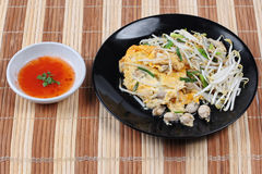 Thai food,Fried egg and oyster with bean sprouts and shallot as. Fried oyster with bean sprouts and shallot as Hoi Tod in Thai served with chili sauce is popular Royalty Free Stock Photos