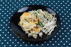 Thai food,Fried egg and oyster with bean sprouts and shallot as. Fried oyster with bean sprouts and shallot as Hoi Tod in Thai served with chili sauce is popular Royalty Free Stock Image