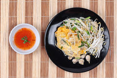 Thai food,Fried egg and oyster with bean sprouts and shallot as. Fried oyster with bean sprouts and shallot as Hoi Tod in Thai served with chili sauce is popular Stock Photos