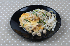 Thai food,Fried egg and oyster with bean sprouts and shallot as Stock Images