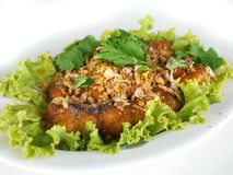 Thai food, fried fish with garlic Royalty Free Stock Image