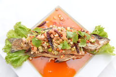 Thai food fried fish with spicy sauce isolated in white backgrou Stock Photo