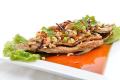Thai food fried fish with spicy sauce isolated in white backgrou Royalty Free Stock Photography