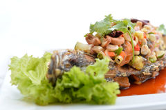 Thai food fried fish with spicy sauce isolated in white backgrou Royalty Free Stock Photo